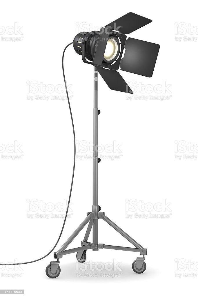 Illuminated studio light on wheels on white background stock photo