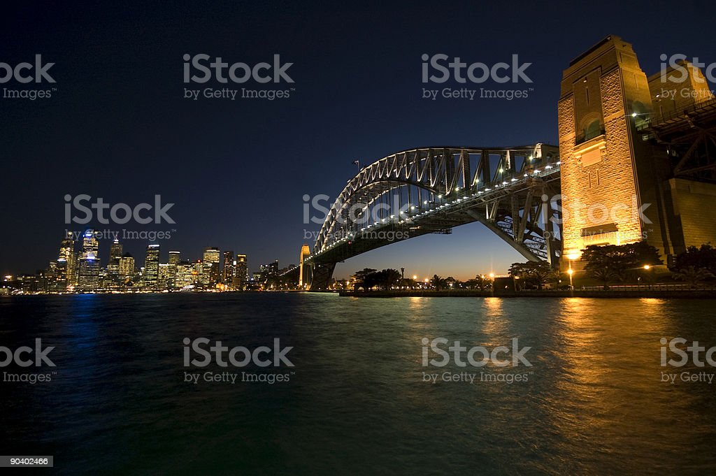 Illuminated Sydney Harbour Bridge with cityscape view stock photo