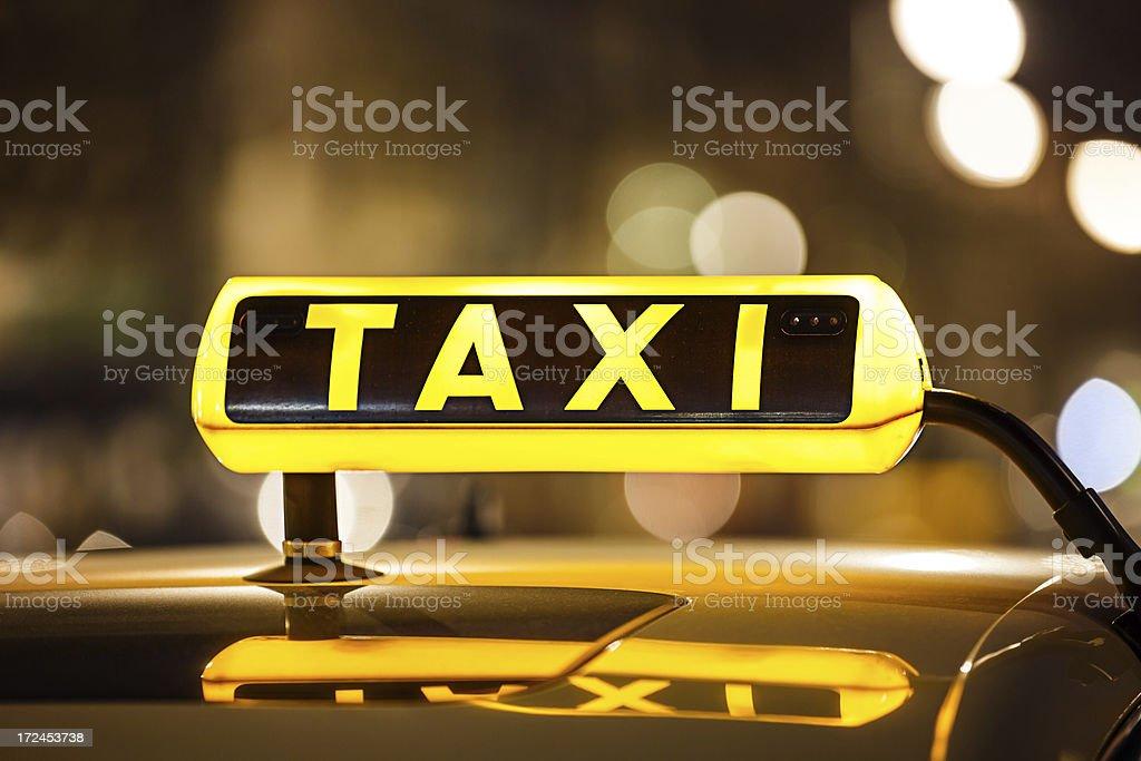 Illuminated Taxi sign stock photo