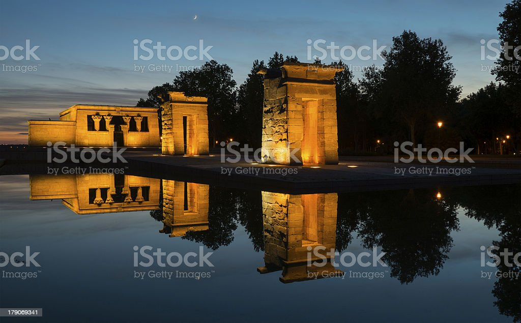 Illuminated templo de Debod and reflection at sunset in Madrid stock photo