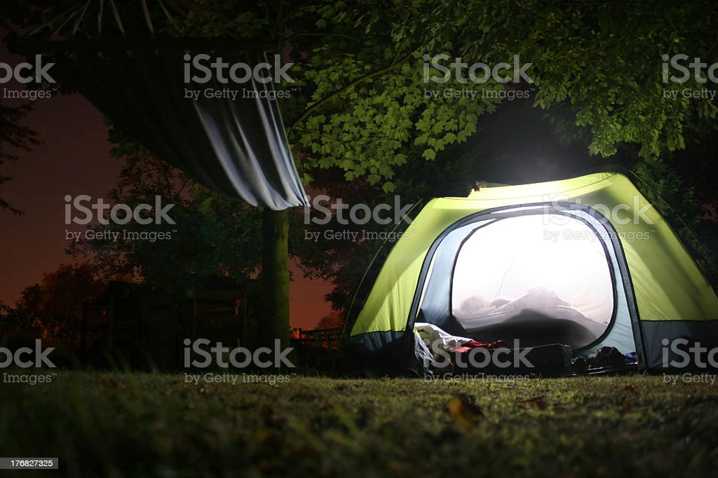 Illuminated tent and hamock at night royalty-free stock photo