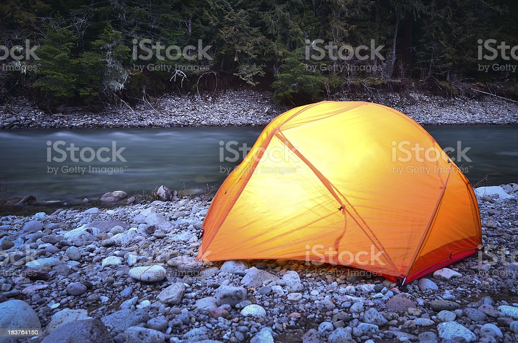 Illuminated tent by river royalty-free stock photo