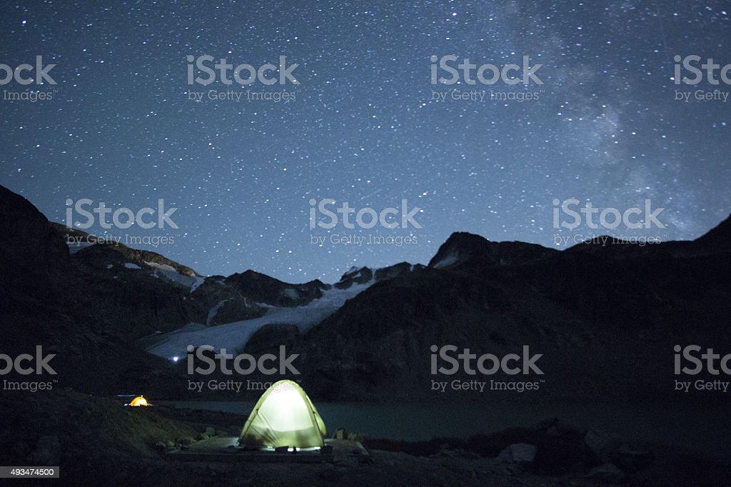 Illuminated Tents in the night sky stock photo