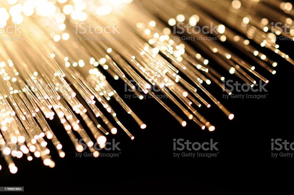 Illuminated tips of fiberglass on black background royalty-free stock photo