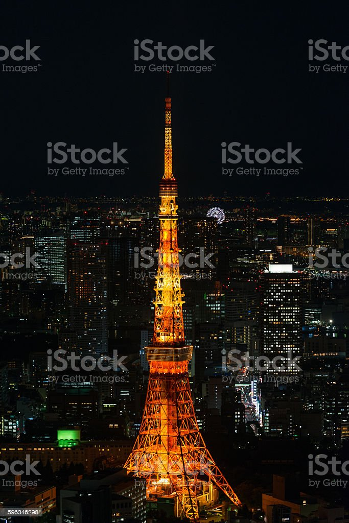 Illuminated Tokyo Tower and skyline at night from Roppongi Hills stock photo