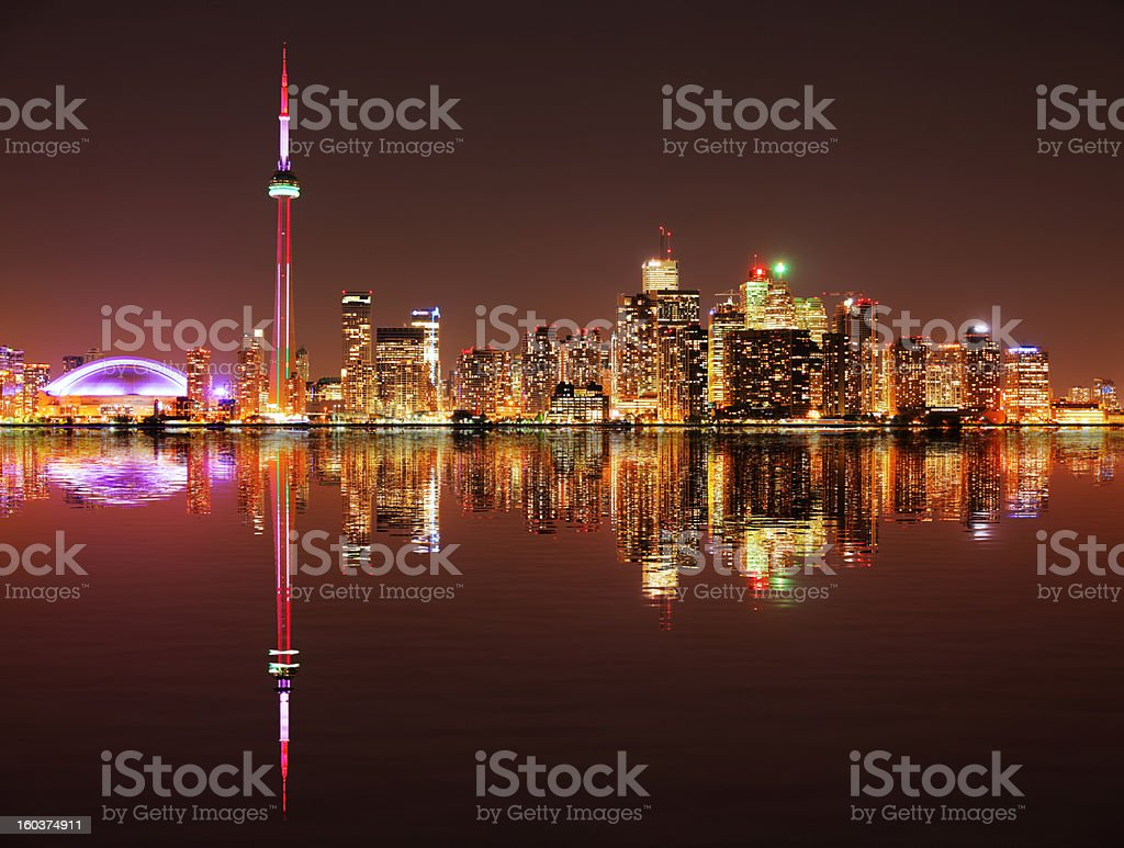 Illuminated Toronto City with Water Reflection at Night stock photo