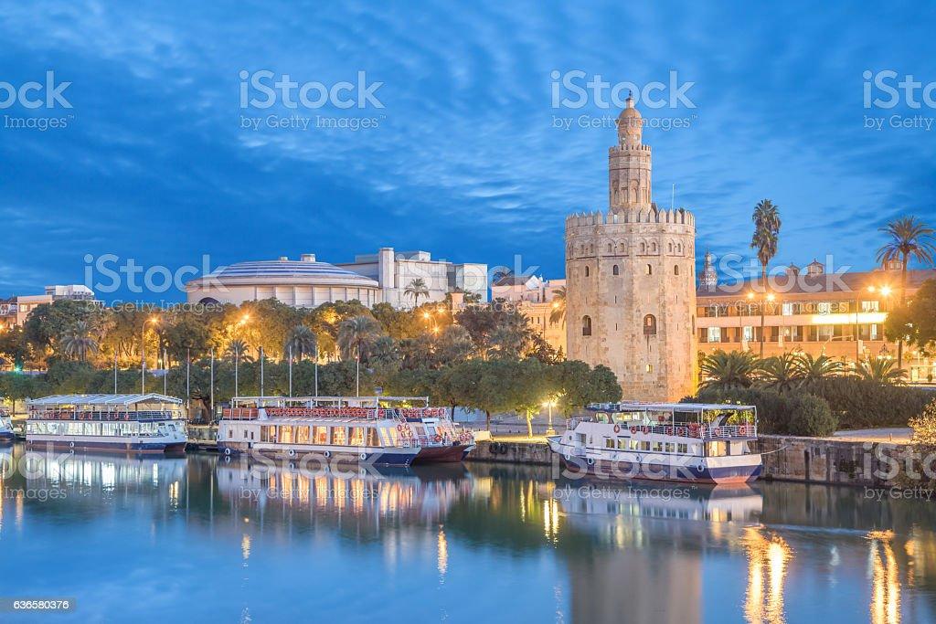Illuminated Torre del Oro in Seville stock photo