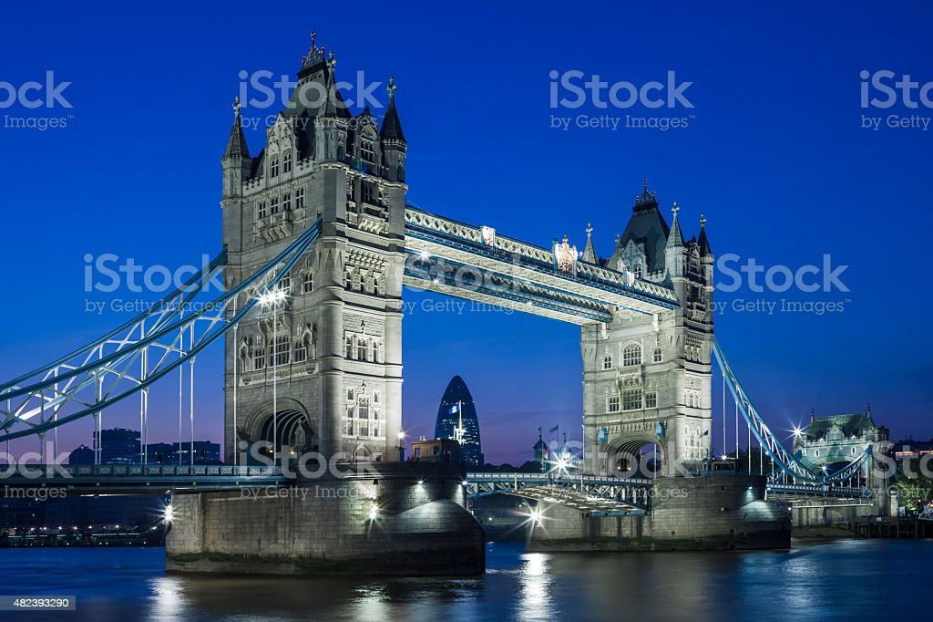 Illuminated Tower Bridge at night and the City of London royalty-free stock photo