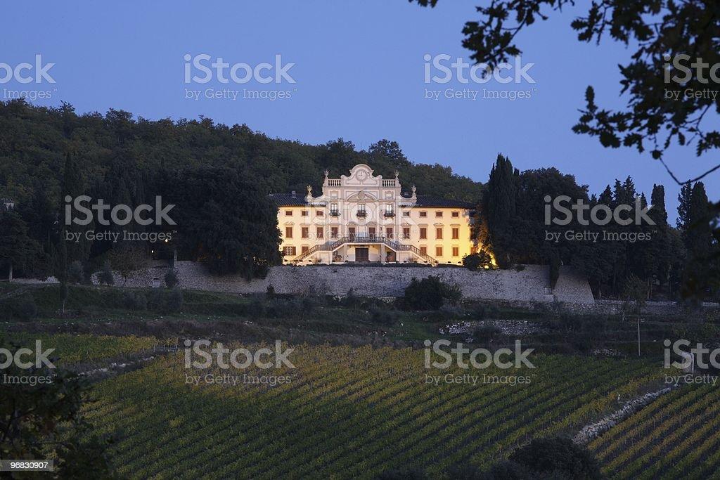 Illuminated Tuscany Villa at Night stock photo