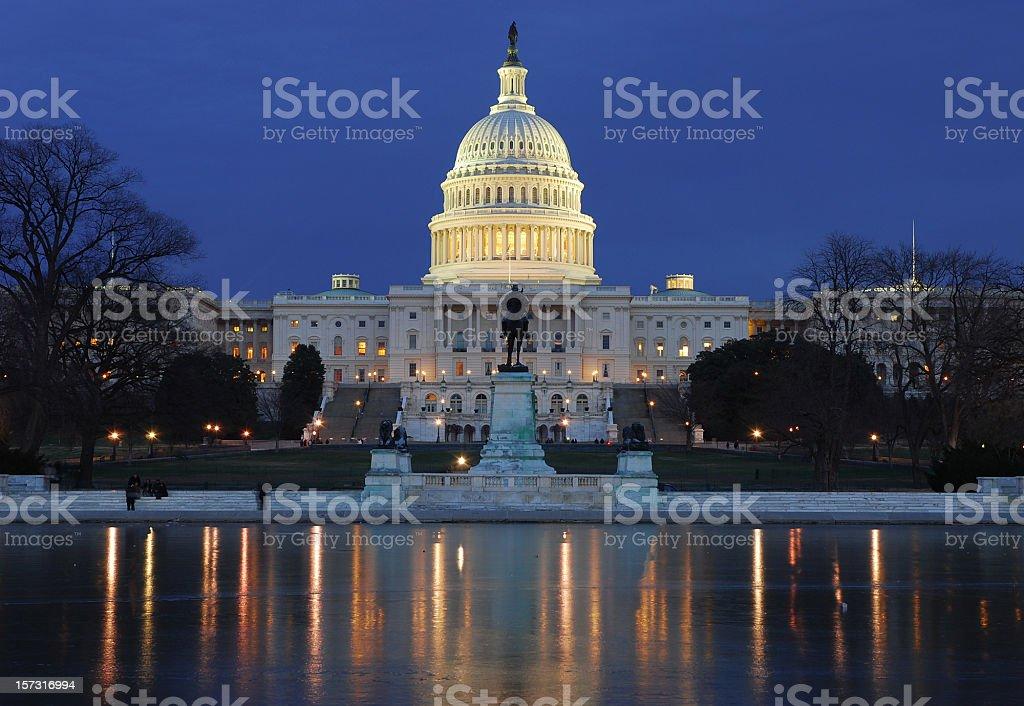 Illuminated US Capitol building with reflection on ice stock photo