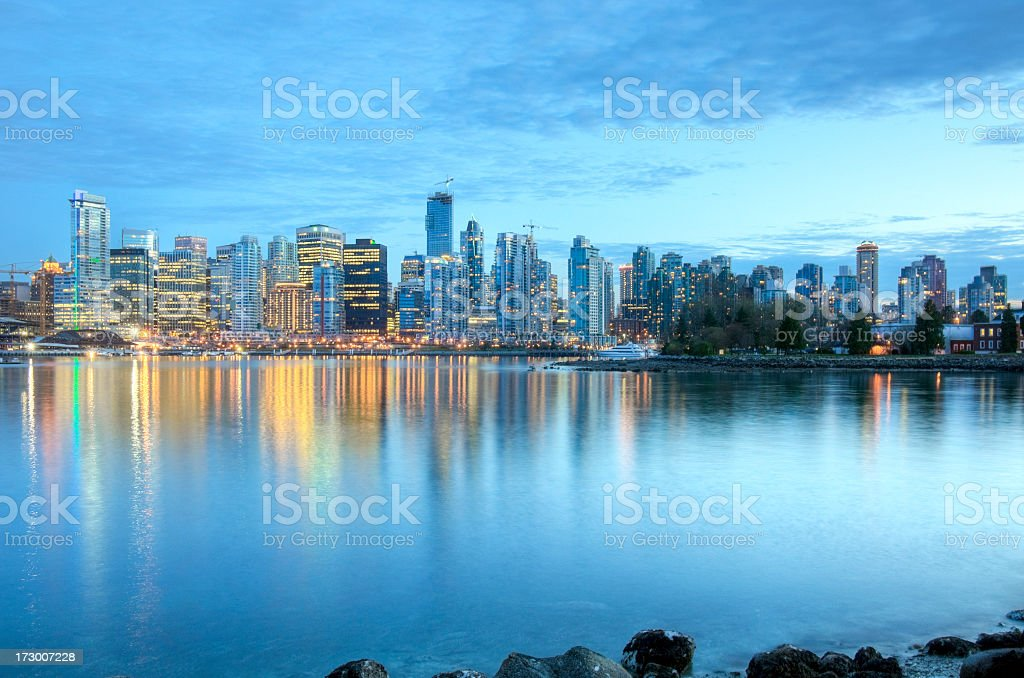 Illuminated Vancouver skyline at dusk as seen from the river stock photo