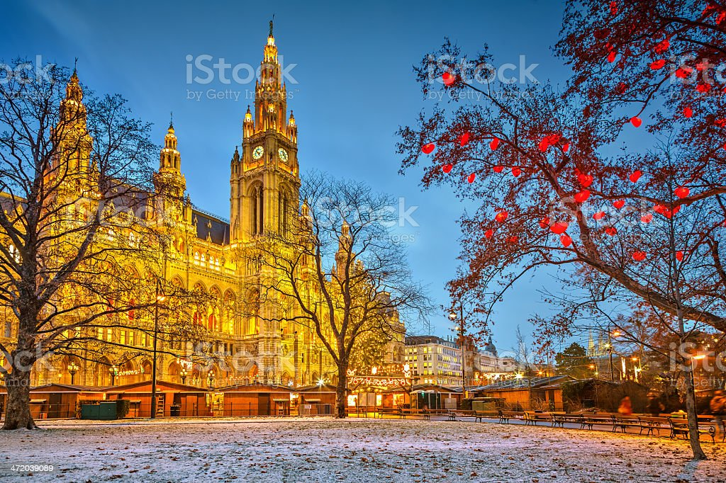 Illuminated Vienna Town Hall building at dusk stock photo