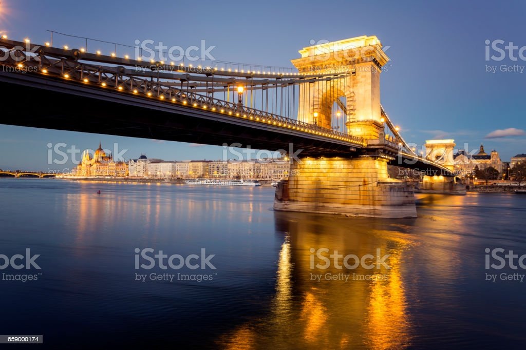 Illuminated view of Chain Bridge and Parliament in Budapest at night stock photo
