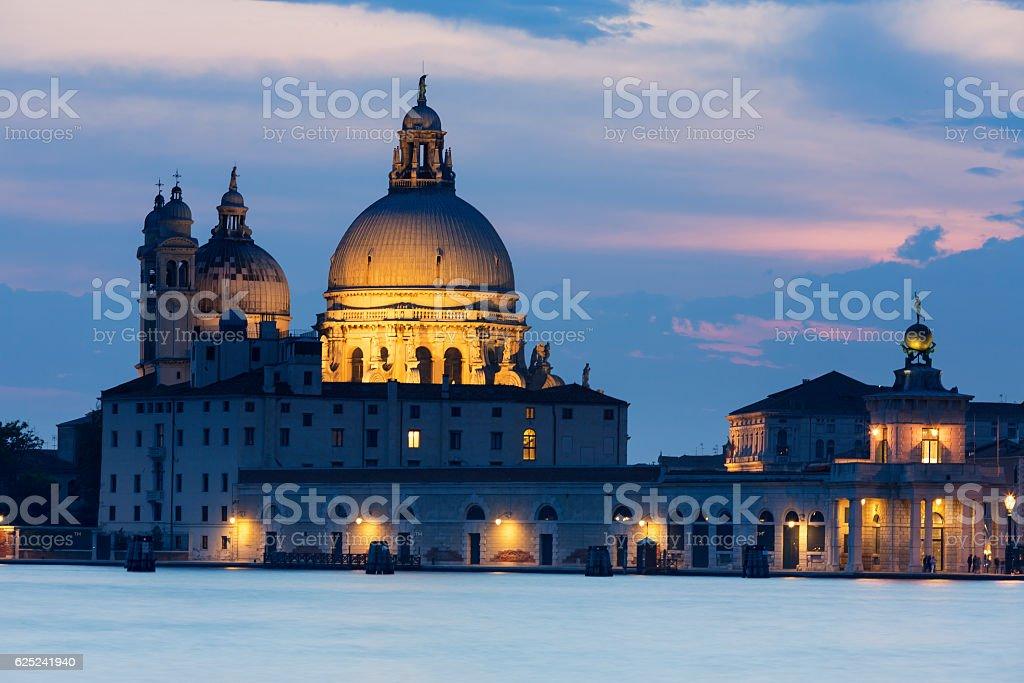 Illuminated view of Santa Maria della Salute at dusk stock photo