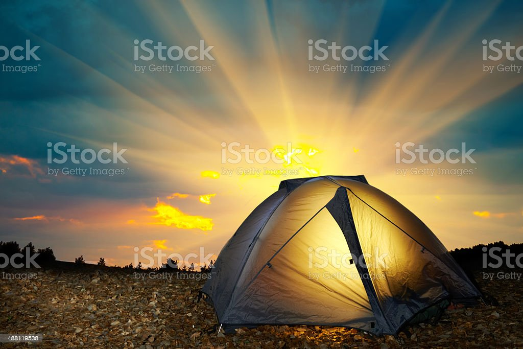 Illuminated yellow camping tent stock photo