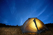 Illuminated yellow camping tent