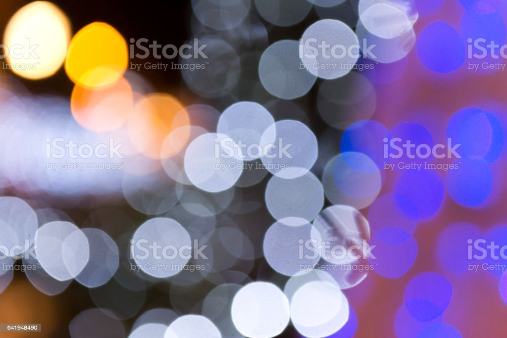 Illumination of Christmas lights with a defocus effect stock photo