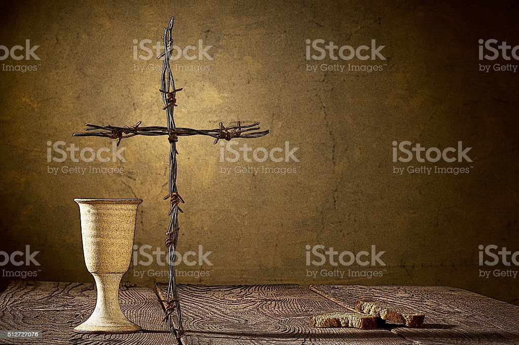 Illustration of chalice and bread on the wooden table stock photo