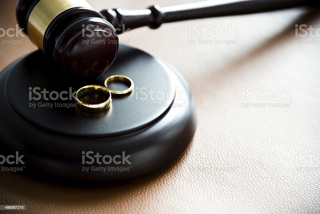 Illustration of divorce concept with two rings on gravel stock photo