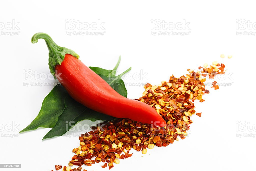 Illustration of fresh red pepper and dried red pepper flakes stock photo