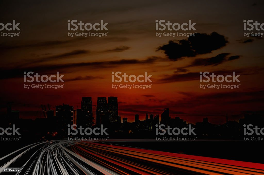 Illustration of lighttrails at night. City in background. stock photo