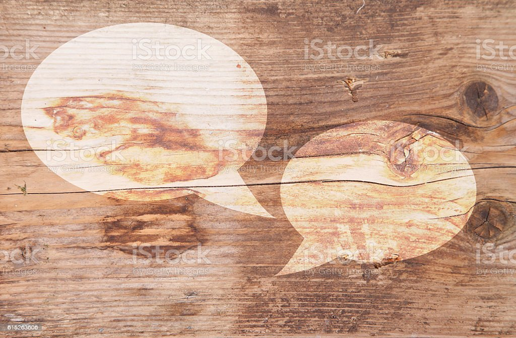 Illustration of white text balloons on brown wooden background stock photo