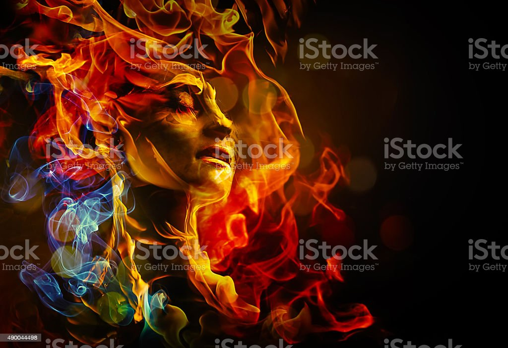 Illustration of woman's face made with fire stock photo
