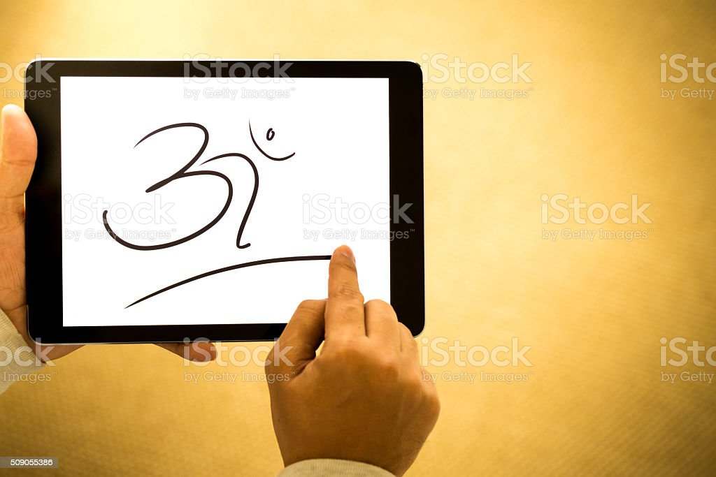 Illustration of word 'Om' on a Digital Tablet stock photo