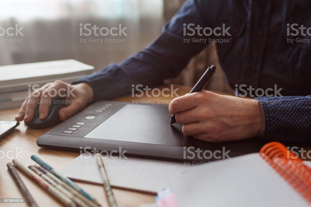 Illustrator draws a sketch stock photo