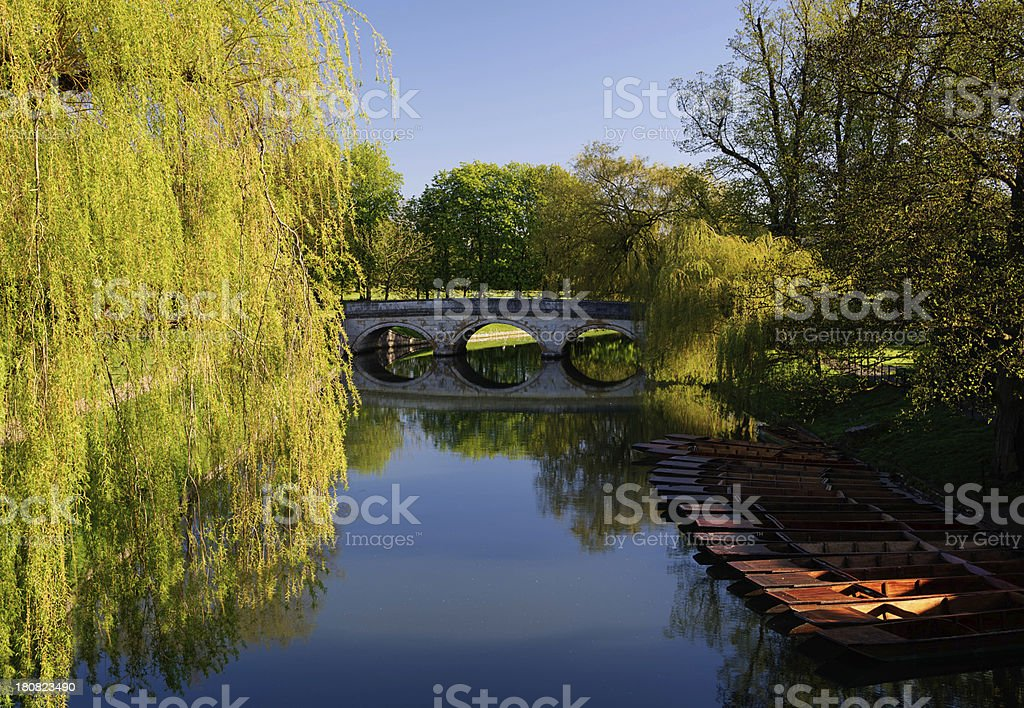 HDR image bridge and punt on river Cam in Cambridge royalty-free stock photo