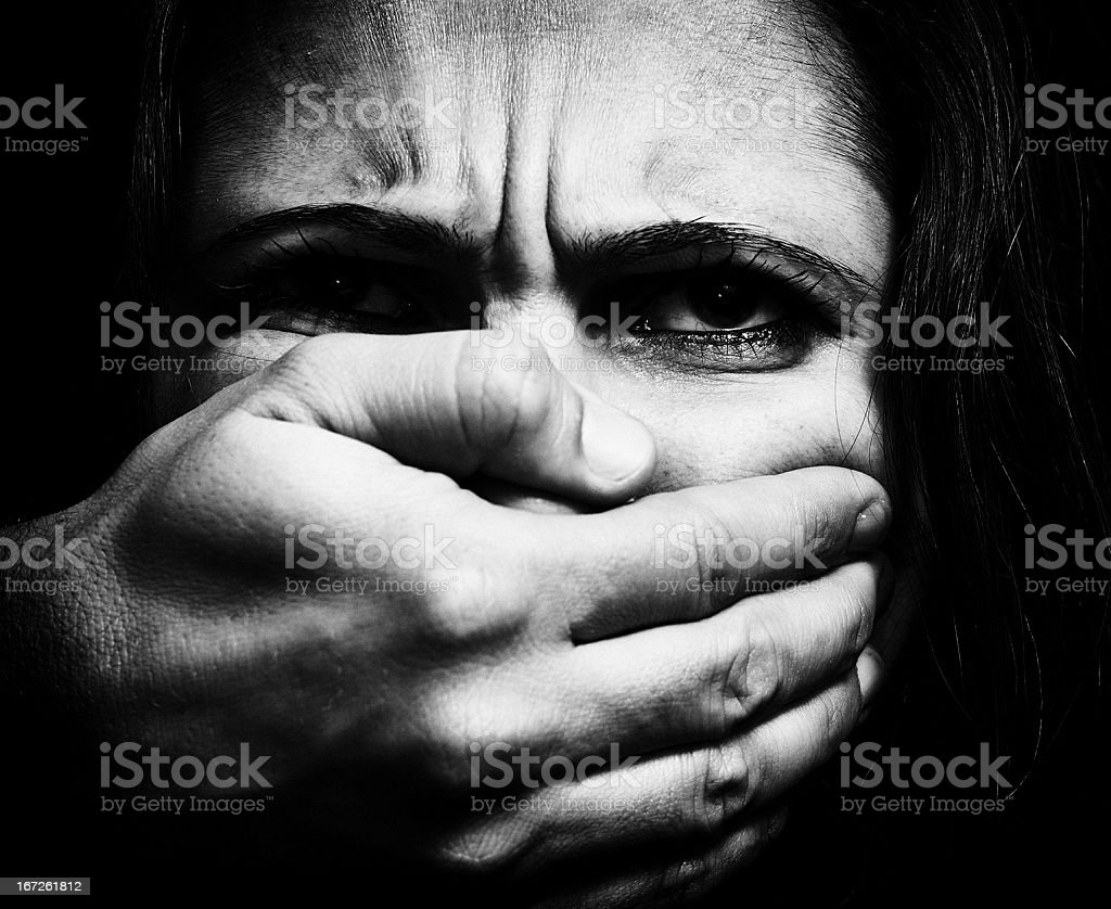 Image displaying a woman being domestically abused stock photo