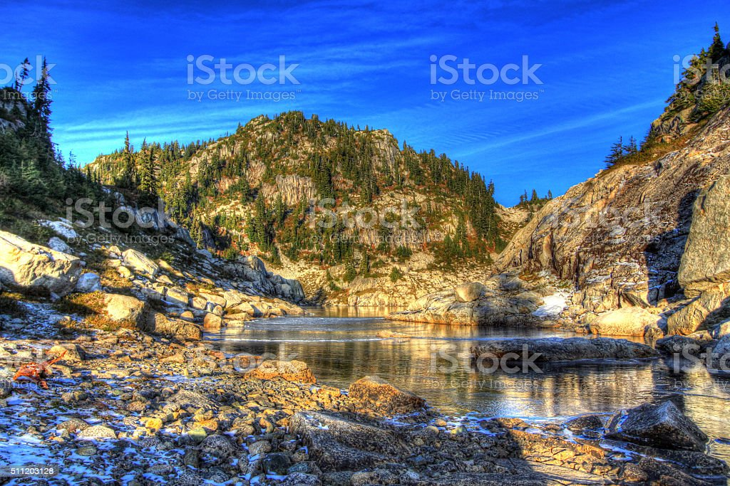 HDR Image: Frozen lake and mountain at sunset. stock photo