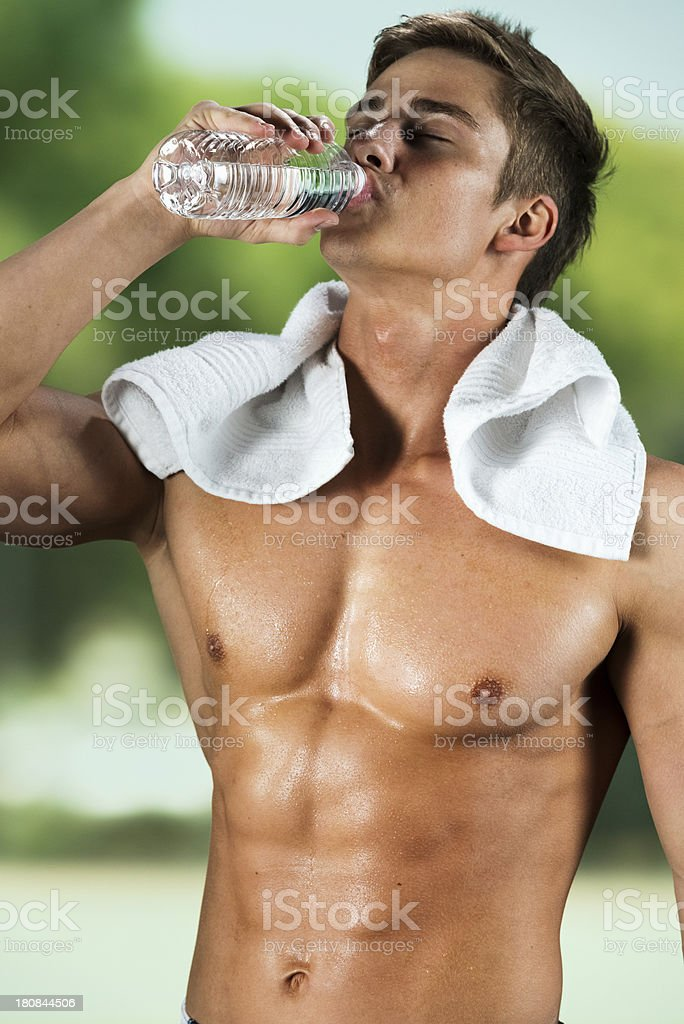 Image of a athlete having water royalty-free stock photo