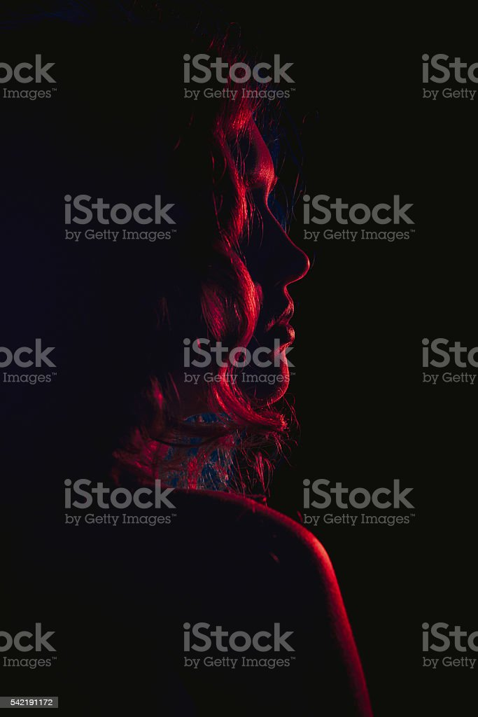 image of a beautiful young woman with flowing hair stock photo