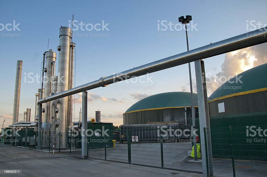 Image of a biogas plant against a blue sky stock photo
