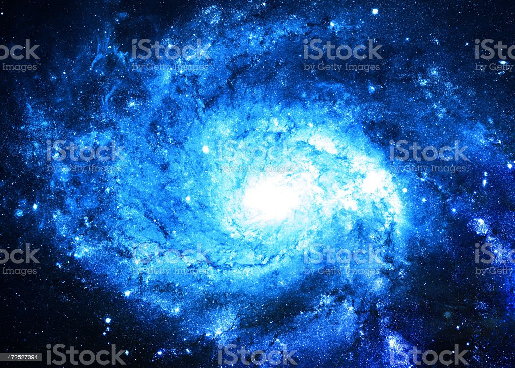 NASA image of a blue spiral galaxy stock photo