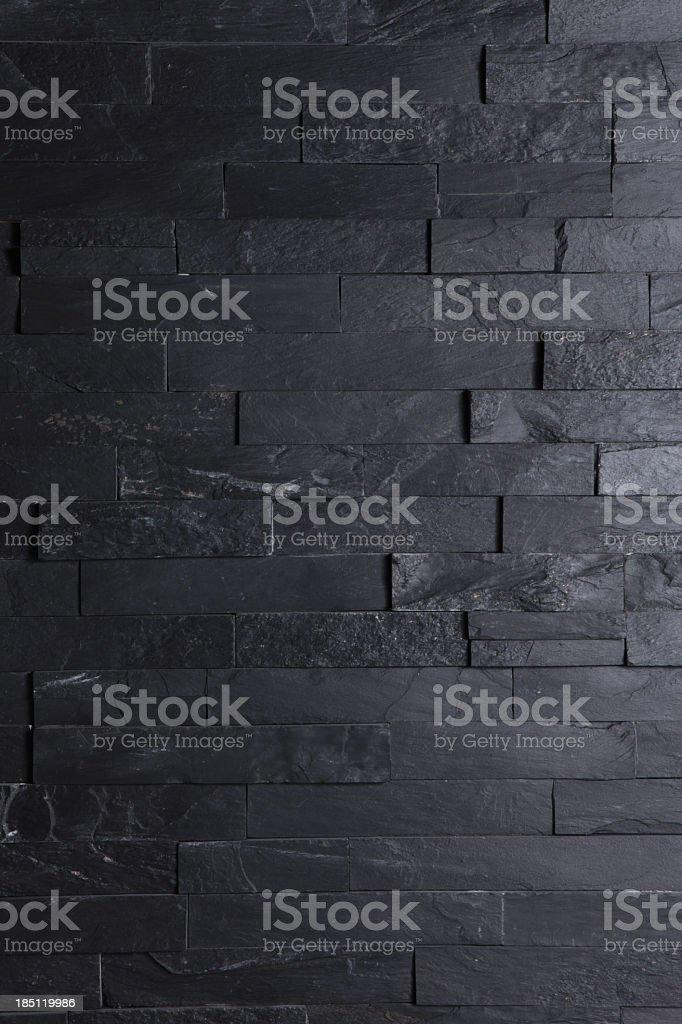 Image of a brick black wall wallpaper stock photo