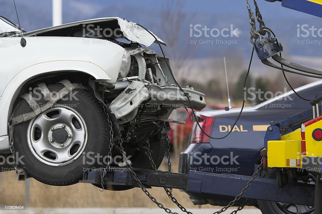 Image of a car collision and tow stock photo