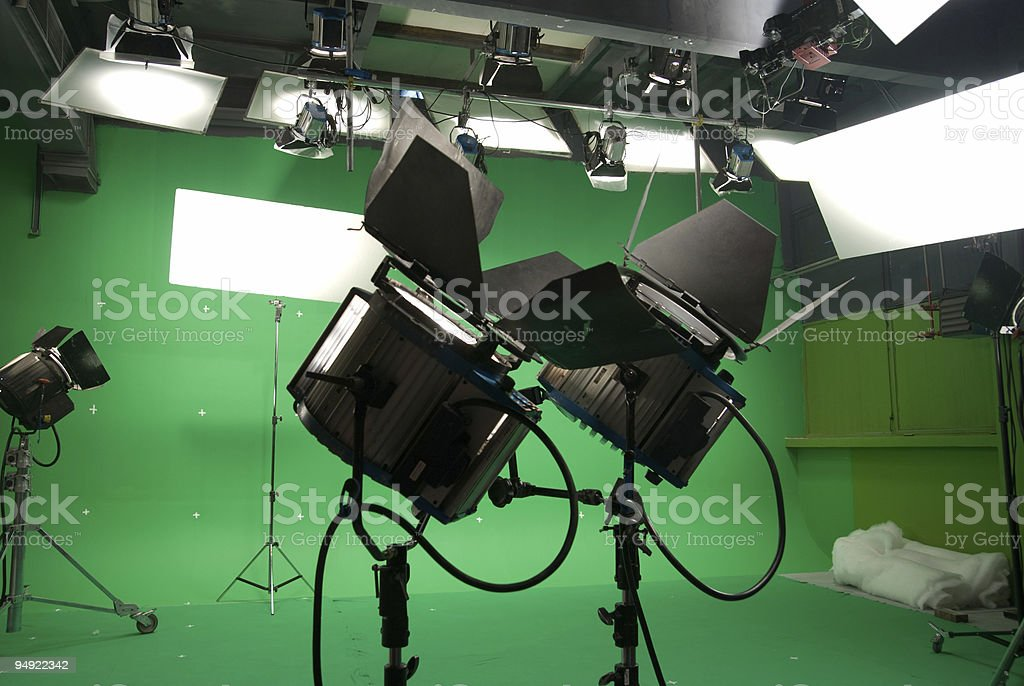 Image of a chroma key studio with green screen and lights stock photo