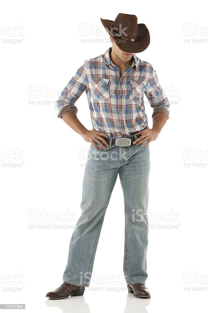 Image of a cowboy with hands on hips. stock photo