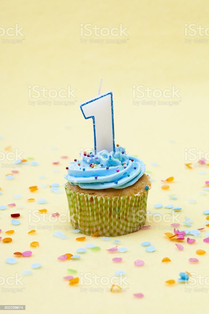 image of a cupcake with birthday candle stock photo