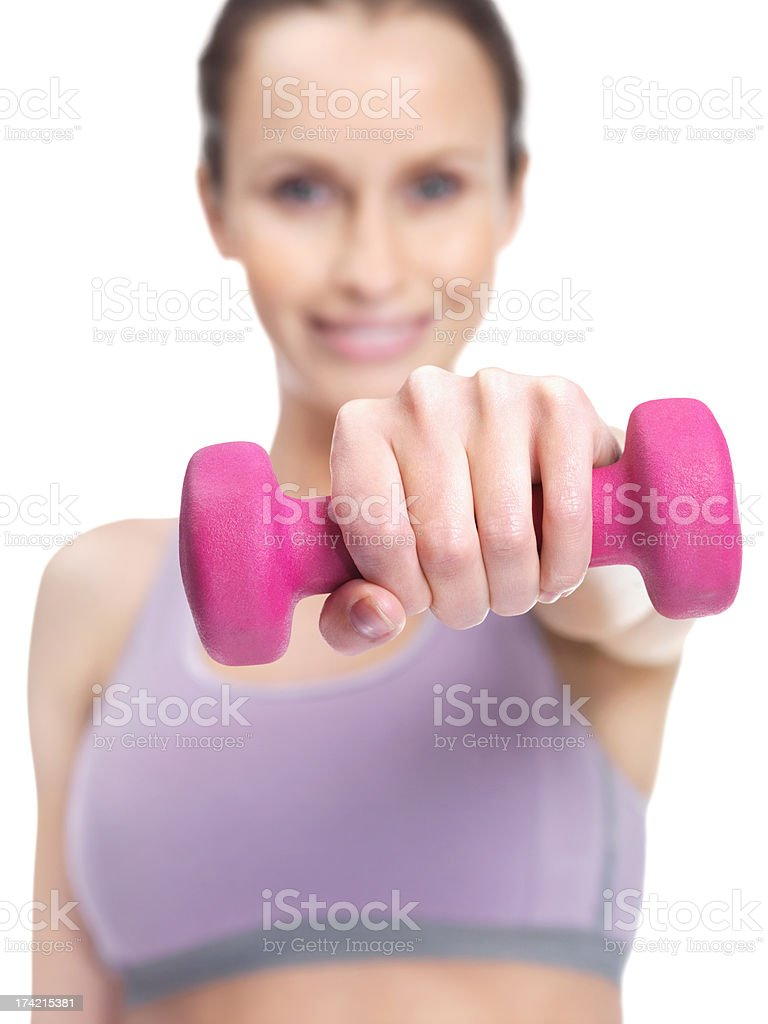 Image of a fitness female working out with pink dumbbells stock photo