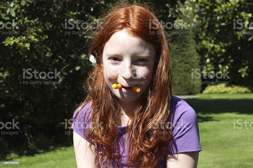 Image of a funny girl pretending to be a walrus stock photo