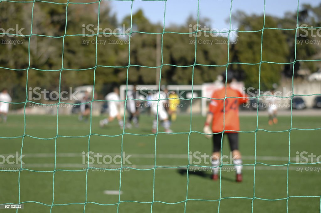 Image of a goalkeeper whatching game, focus the net royalty-free stock photo