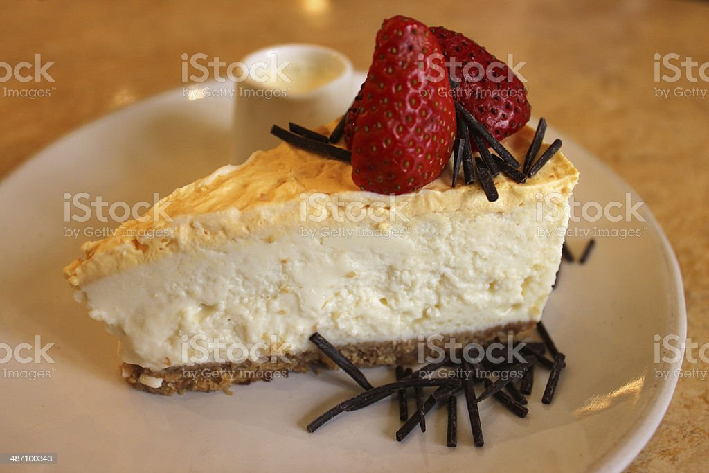 Image of a lemon cheesecake topped with strawberries stock photo