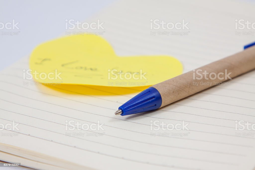 image of a notebooks and pencil on white background stock photo
