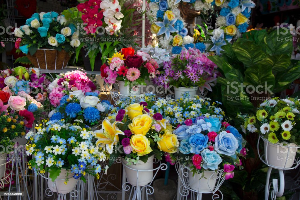 image of a plastic flowers , Artificial flowers , flowers in pots , Artificial colorful flowers pots, flowers shop , rose stock photo