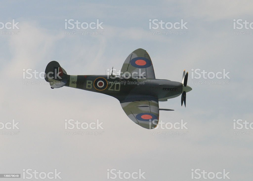 Image of a spitfire plane flying in the air royalty-free stock photo