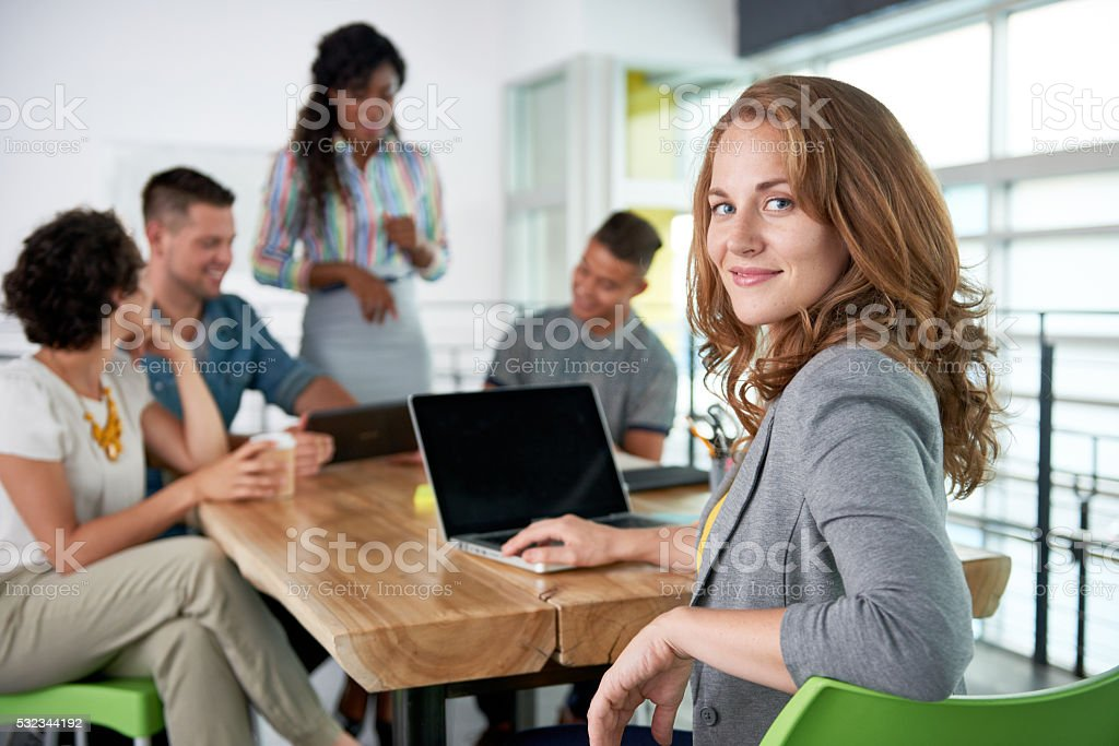 Creative blond businesswoman leading hes team in a friendly...