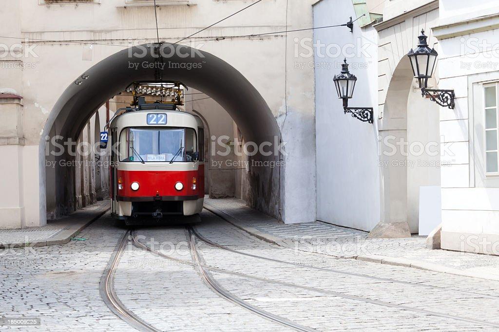Image of a tram under a bridge in Prague stock photo